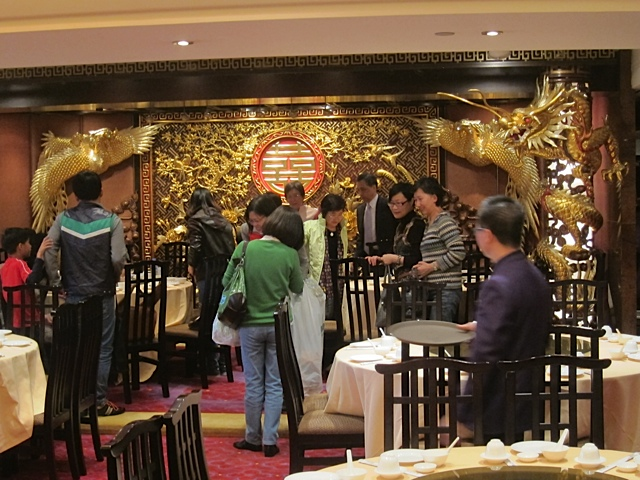 Chinese diners arrive in the golden-dragon splendor of the second floor