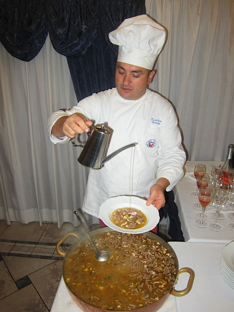 Carmine himself applying the olive oil at tableside