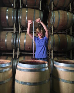 Denise Shurtleff of Cambria Wines doing the punch down